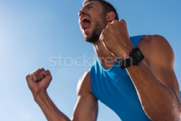 триумф возбужденный спортсмен Smart Смотреть Сток-фото © LightFieldStudios