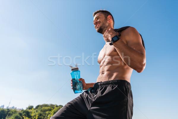Sportoló sport üveg izmos póló nélkül okos Stock fotó © LightFieldStudios