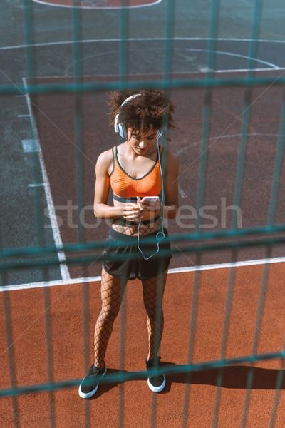 женщину наушники молодые спортивная одежда спортивных Сток-фото © LightFieldStudios