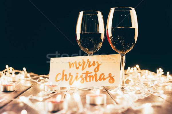 wine and merry christmas card Stock photo © LightFieldStudios