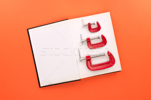 Stock photo: open notebook and c-clamps