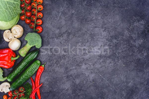 top view of fresh healthy assorted vegetables on black Stock photo © LightFieldStudios