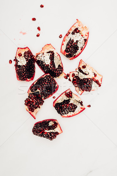 top view of pomegranates pieces isolated on white Stock photo © LightFieldStudios