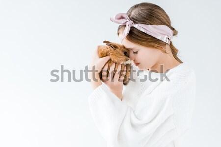 Gyönyörű lány tart imádnivaló szőrös nyuszi izolált Stock fotó © LightFieldStudios