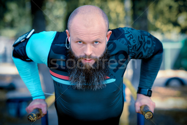 Man parallel bars park Stockfoto © LightFieldStudios