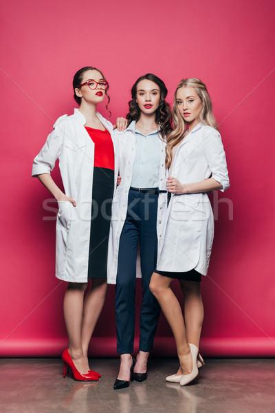 три врачи медицинской розовый женщины Сток-фото © LightFieldStudios