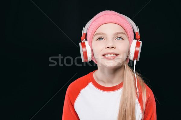 Portrait of beautiful smiling girl in sportswear wearing headphones, activities for children concept Stock photo © LightFieldStudios