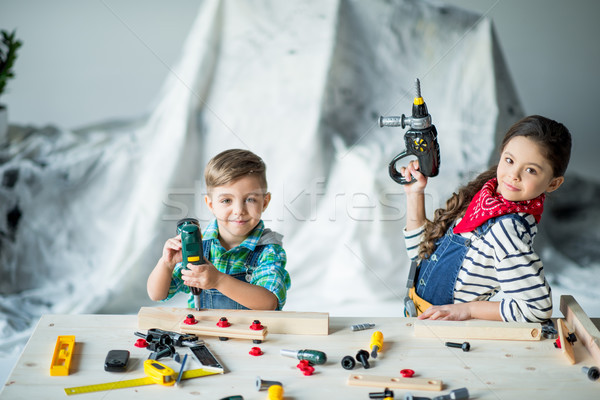 Boy and girl with tools Stock photo © LightFieldStudios