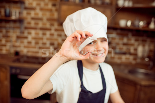 boy in chef hat holding star shaped cookie cutter   Stock photo © LightFieldStudios