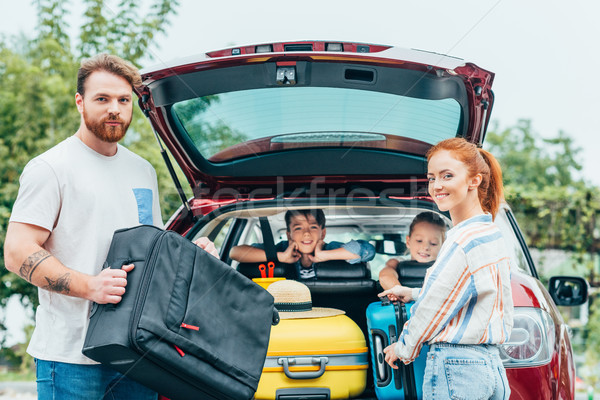family packing luggage in trunk Stock photo © LightFieldStudios