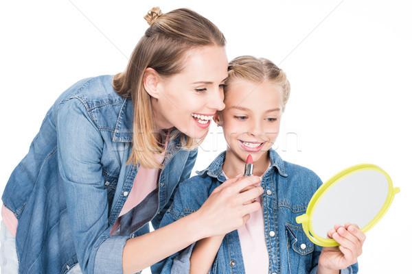 daughter applying makeup Stock photo © LightFieldStudios