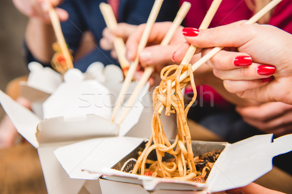People eating noodles Stock photo © LightFieldStudios