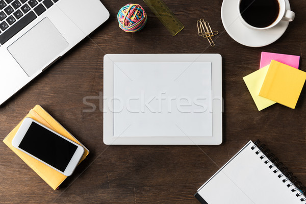 top view of tablet and other digital devices on home office table Stock photo © LightFieldStudios