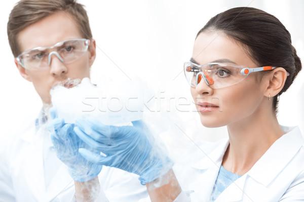 Genç profesyonel gözlük deney sıvı Stok fotoğraf © LightFieldStudios
