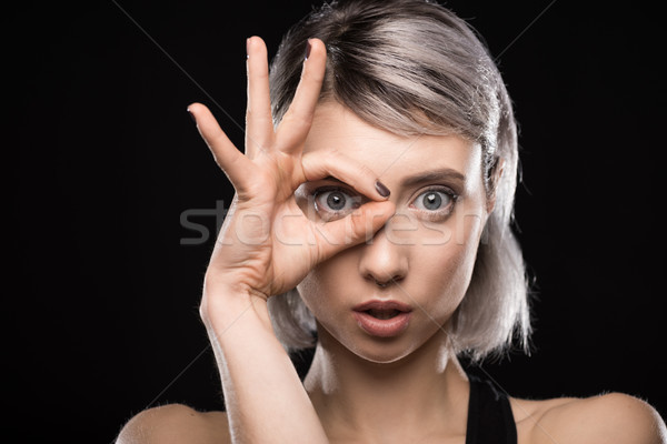 portrait of shocked woman showing ok sign on black Stock photo © LightFieldStudios