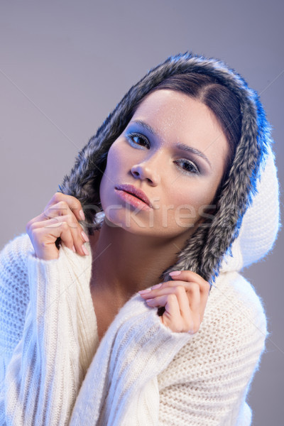 woman in hooded sweater Stock photo © LightFieldStudios