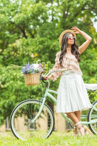 beautiful girl with bicycle Stock photo © LightFieldStudios