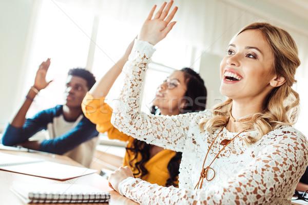 students raising hands in class Stock photo © LightFieldStudios