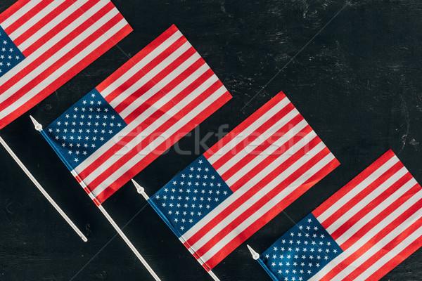 Felső kilátás amerikai zászlók sötét felület Stock fotó © LightFieldStudios