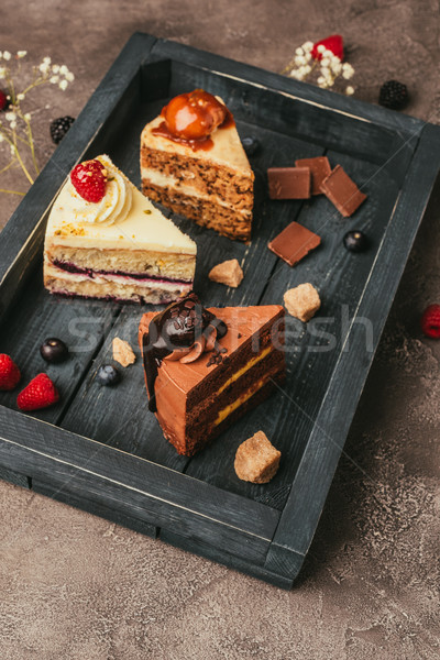 close-up view of pieces of delicious cakes on wooden tray  Stock photo © LightFieldStudios