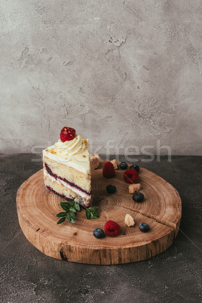 piece of delicious fruity cake with whipped cream on wooden board Stock photo © LightFieldStudios