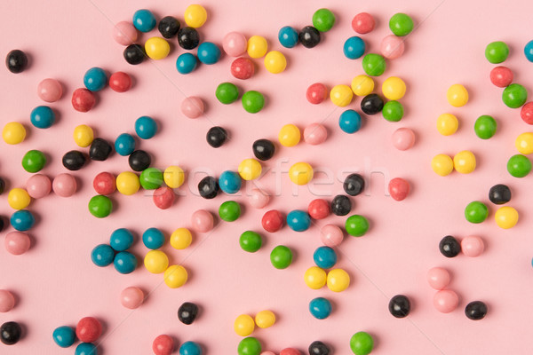 close up view of various candies isolated on pink Stock photo © LightFieldStudios