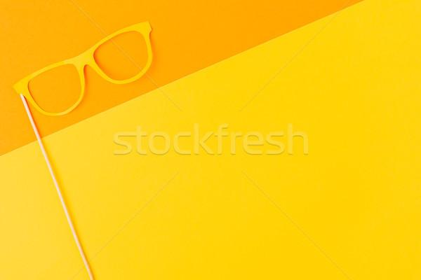 top view of masquerade mask on yellow and orange background Stock photo © LightFieldStudios