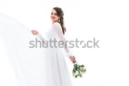 attractive bride posing in traditional wedding dress with crossed arms, isolated on white Stock photo © LightFieldStudios
