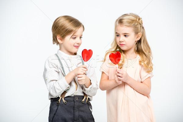 Kids with heart shaped lollipops Stock photo © LightFieldStudios