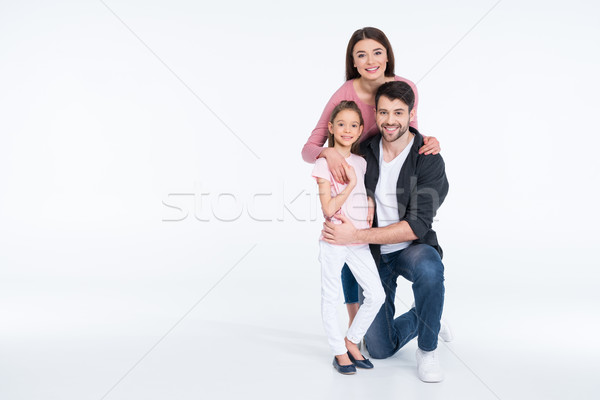 Happy young family with one child hugging on white Stock photo © LightFieldStudios