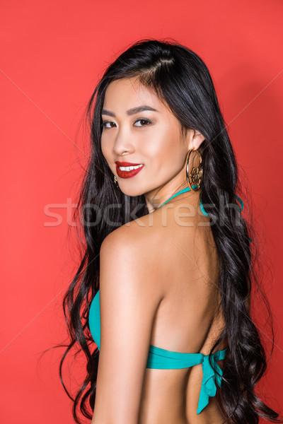Smiling asian woman Stock photo © LightFieldStudios