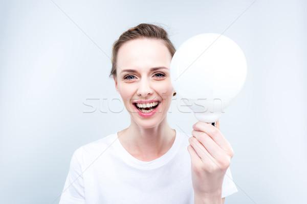 éclairage femme ampoule belle isolé Photo stock © LightFieldStudios