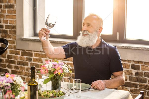 senior man with empty wine glass Stock photo © LightFieldStudios