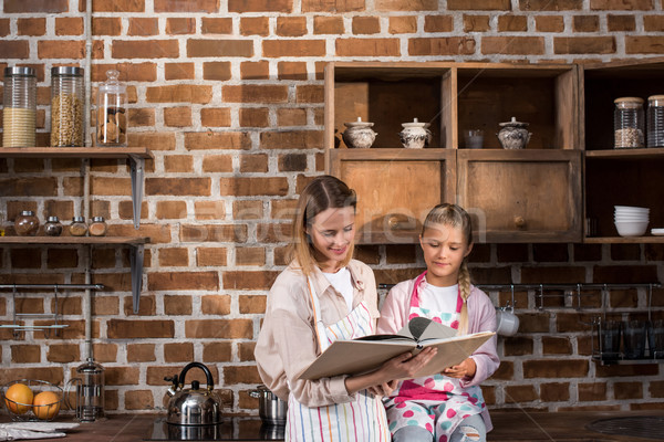 family reading cookery book Stock photo © LightFieldStudios