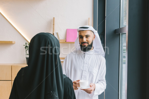 muslim couple drinking coffee Stock photo © LightFieldStudios