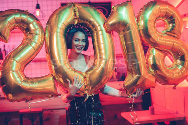 african american woman with balloons Stock photo © LightFieldStudios