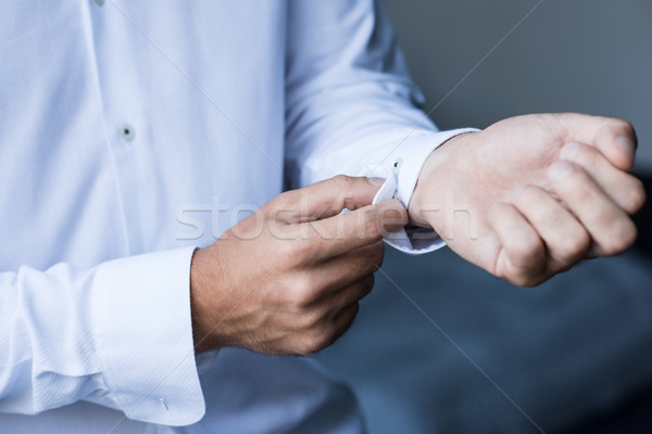 man buttoning up cuffs Stock photo © LightFieldStudios