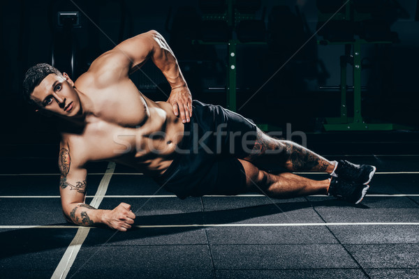 sportsman doing side plank Stock photo © LightFieldStudios
