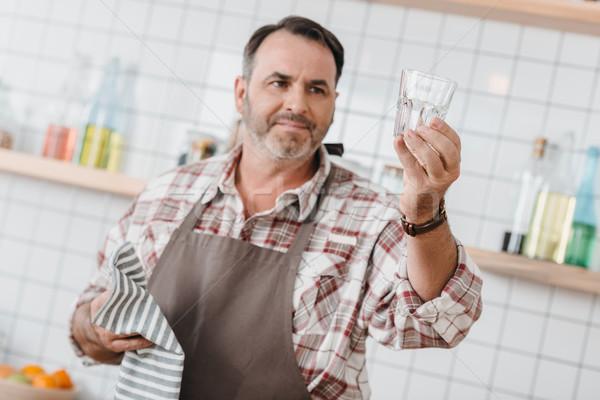 bartender looking at clean glass Stock photo © LightFieldStudios