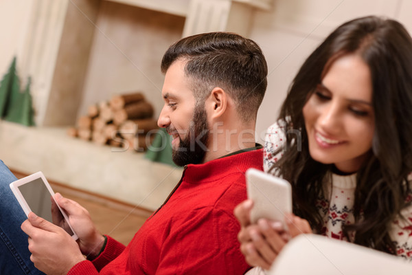 Stock photo: couple using digital devices