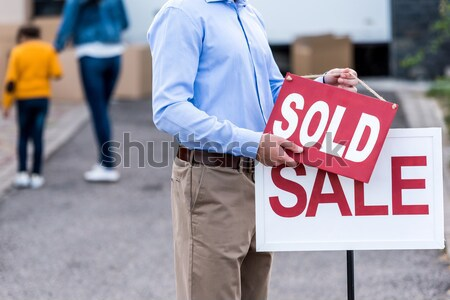 man hanging sold sign Stock photo © LightFieldStudios