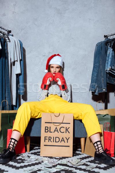 Noël black friday fille gants de boxe chapeau Photo stock © LightFieldStudios