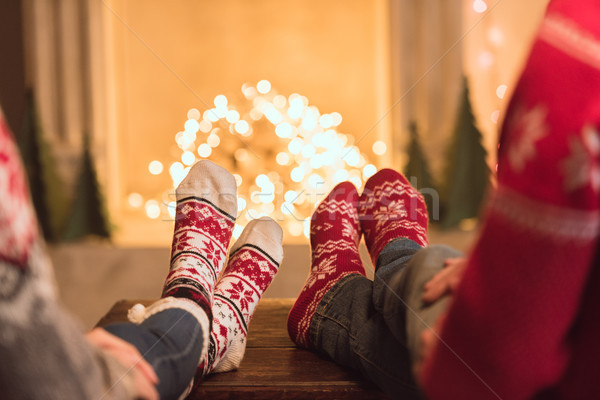 couple in knitted socks near fireplace Stock photo © LightFieldStudios