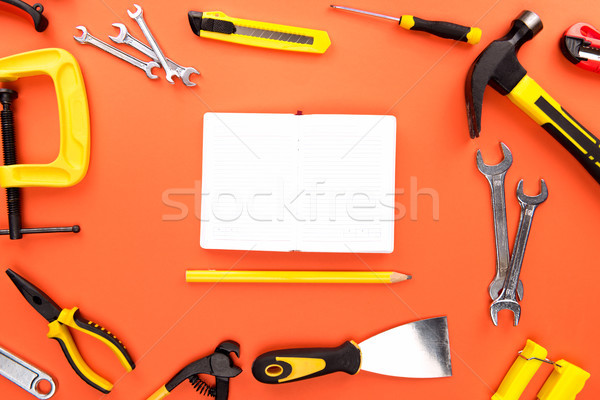 Stock photo: open notebook and reparement tools