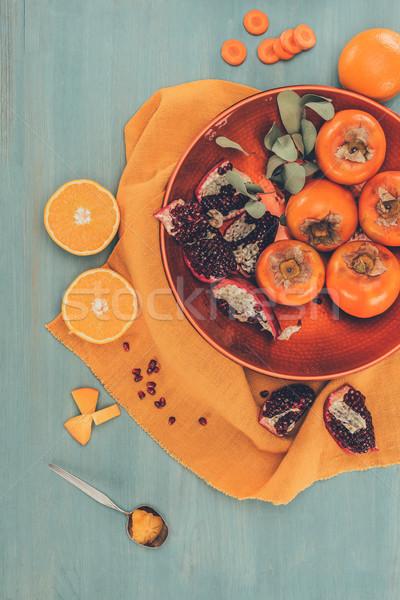 Superior vista maduro frutas placa naranja Foto stock © LightFieldStudios