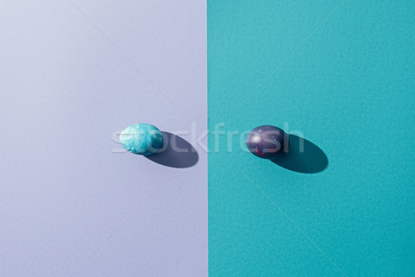 top view of traditional easter eggs, on blue and purple Stock photo © LightFieldStudios
