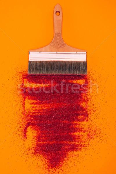 Górę widoku czerwony piasku dekoracji szczotki Zdjęcia stock © LightFieldStudios