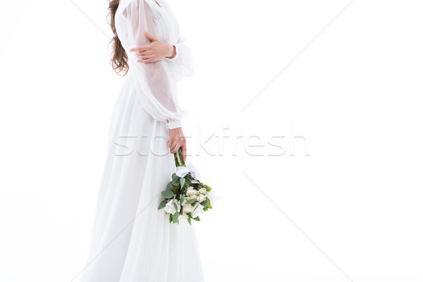 cropped view of bride in traditional dress with wedding bouquet, isolated on white Stock photo © LightFieldStudios