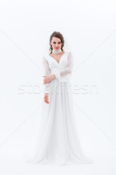 Schönen lächelnd Braut posiert traditionellen Hochzeitskleid Stock foto © LightFieldStudios