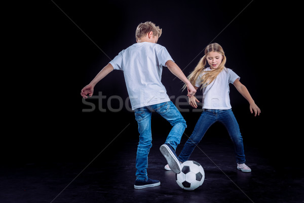 Fivér lánytestvér játszik futballabda boldog fekete Stock fotó © LightFieldStudios